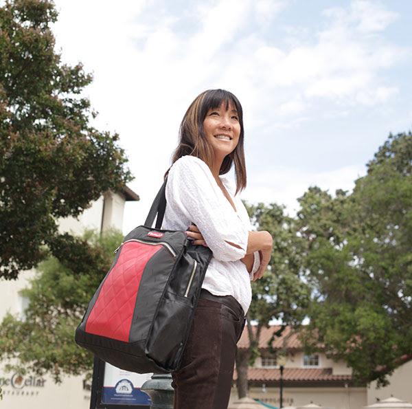 MotoChic owner Debra Chin with Lauren bag